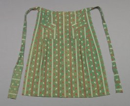 Apron embroidered with green, white and orange flowers