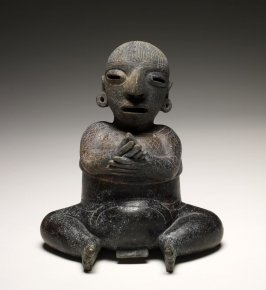 Lidded jar with seated figure