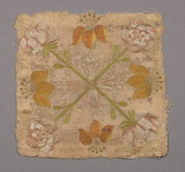 Fragment of yellow silk with gold thread and color floral pattern woven in