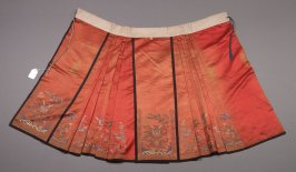 Skirt dragons and birds on orange with black trim
