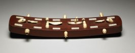 Cribbage board with carved animals