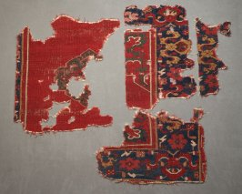 Four fragments of an Ushak carpet