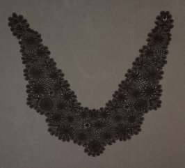 Collar black, with sun and star design