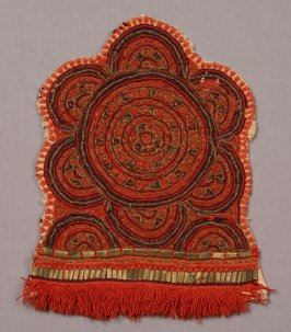 one of pair of fringed and embroidered patches with metal bits.