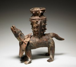 Incense burner in the form of a dog carrying a spiked vase