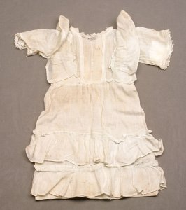 Doll dress faded blue-green with lace insert and edging on short sleeve