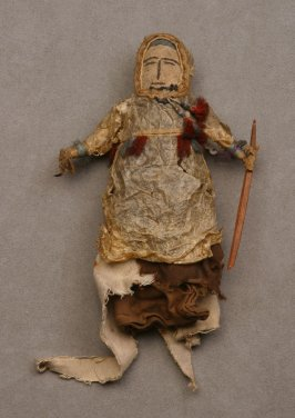 Handmade doll holding a spear