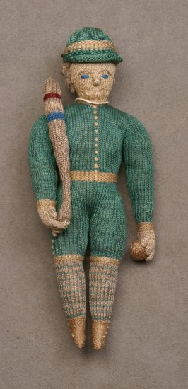 Doll: ball player in green uniform with bat and ball