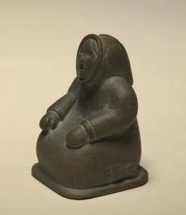 Seated Woman with Elongated Hood Pulled onto Head