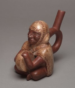 Stirrup spout vessel with drummer
