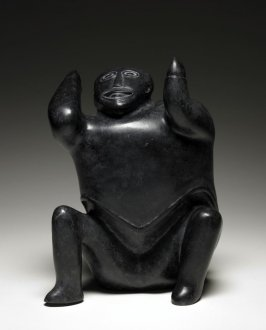 Seated figure with arms in air and head looking skyward