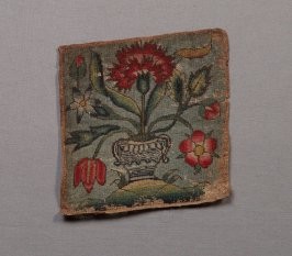 Small square embroidered with floral spray in vase