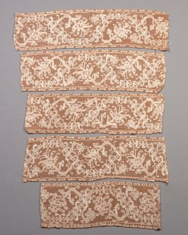 Five sections of filet lace