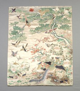 Table cover with pattern of birds and branches with sun on white ground