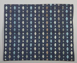 Textile fragment: oblong shapes and lines; blue and yellow on dark blue