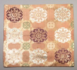 Textile fragment :circular floral pattern; purple, white and green on orange