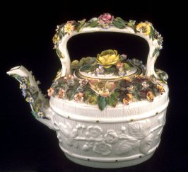 Teapot and lid with raised floral design