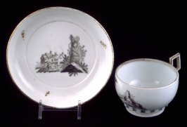 """Cup and saucer with houses, """"E. Sam"""" on saucer"""