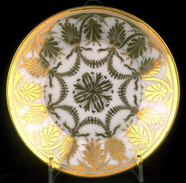 White saucer with gold decoration
