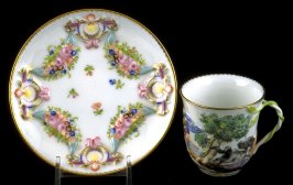 Cup and saucer with floral and allegorical reliefs