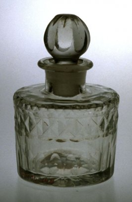Cologne bottle with stopper and diamond pattern