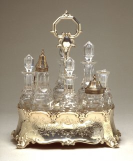 Cruet stand with eight fitted bottles