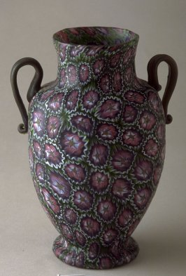 Vase with purple flowers