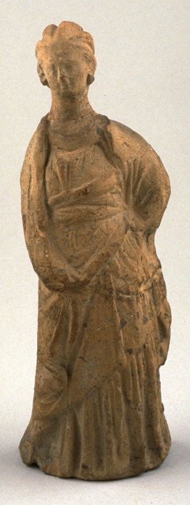Standing draped female figure with hand on hip