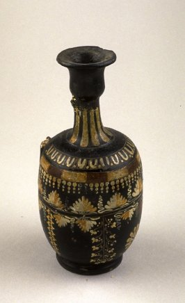 Jug with tall neck, black with yellow, red, and white dots and leaves