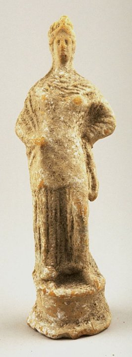 Standing draped female figure with high headdress