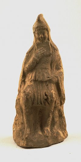 Seated figure wearing Phrygian