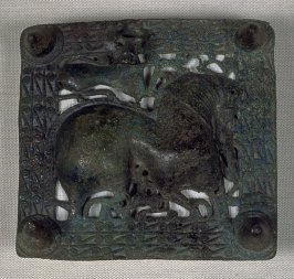Pierced plaque with figure of horse surmounted by bull