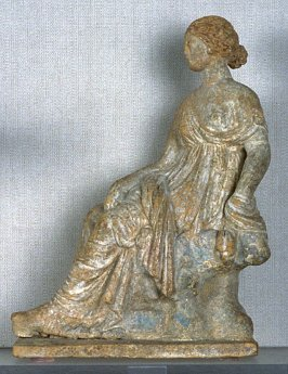 Woman Seated on a Rock