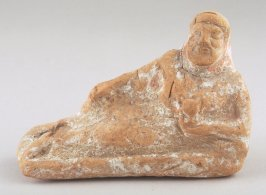 Reclining male figure with beard