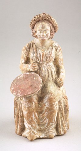 Seated female figure with wreath on head