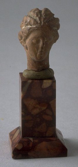 Tanagra figure - head of a Woman
