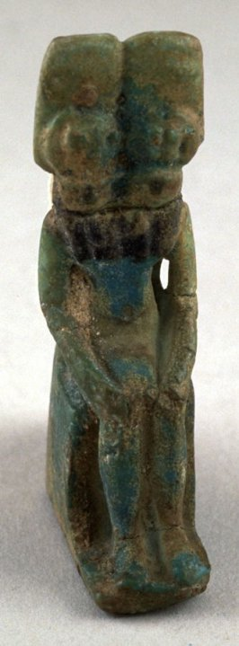 Seated two-headed goddess