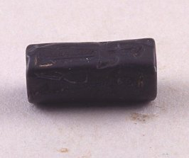 Cylinder seal with armed figure
