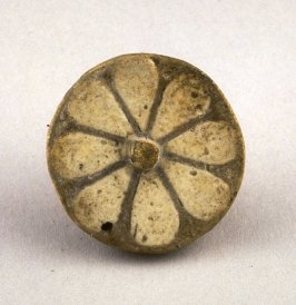 Button amulet