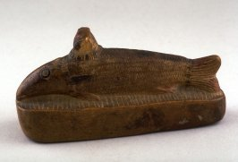 Statuette of sacred fish wearing Hathor's headdress