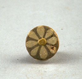 Flowered tile with white rosette and yellow center