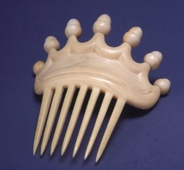 Comb with acorn design