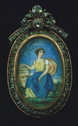 Portrait of kneeling woman in blue and yellow dress