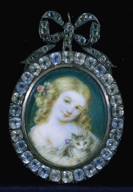 Portrait of a young girl with kitten