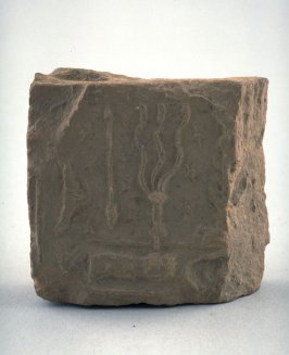 Stone fragment with relief carving w/ spear, whip, 3 branches, Casale written on itL.M. Kaye on it