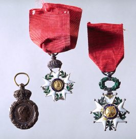 Box containing a) Order of Legion of Honor b) Medal of 1870 c) Napoleon medal (copper)