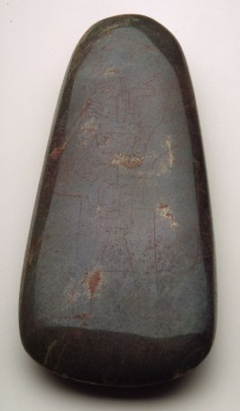 Celt or ceremonial axe with incised standing figure