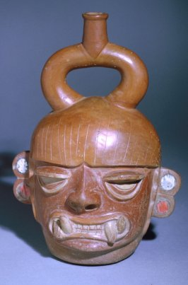 Portrait vessel of a fanged deity
