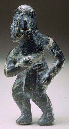 Standing male figure dark green, with loincloth