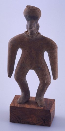 Standing figure, arms at sides